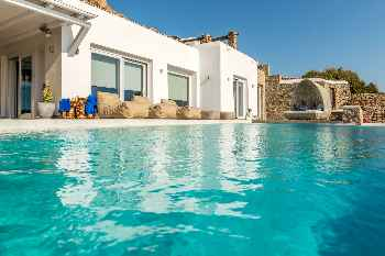 ~Villa Luxulo Mykonos 6 Bedrooms 6 Bathrooms 5 en suite plus 1, with an excellent view to Delos Island and a magnificent sunsets